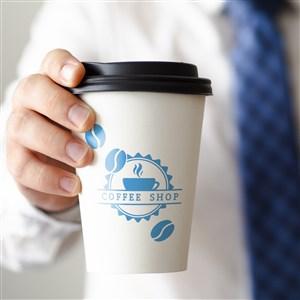商务男士手拿咖啡杯贴图样机