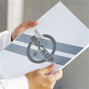 商务人士手捧企业画册贴图样机