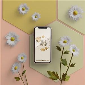 小雛菊旁邊的手機貼圖樣機