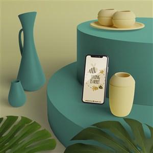 3D花瓶旁邊的手機貼圖樣機