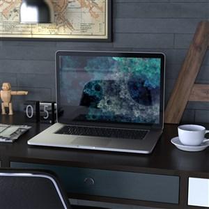 辦公桌上的手提電腦貼圖樣機