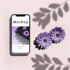 带鲜花和阴影的手机贴图样机