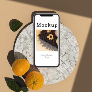 大理石圆台上有柑橘和阴影的手机贴图样机