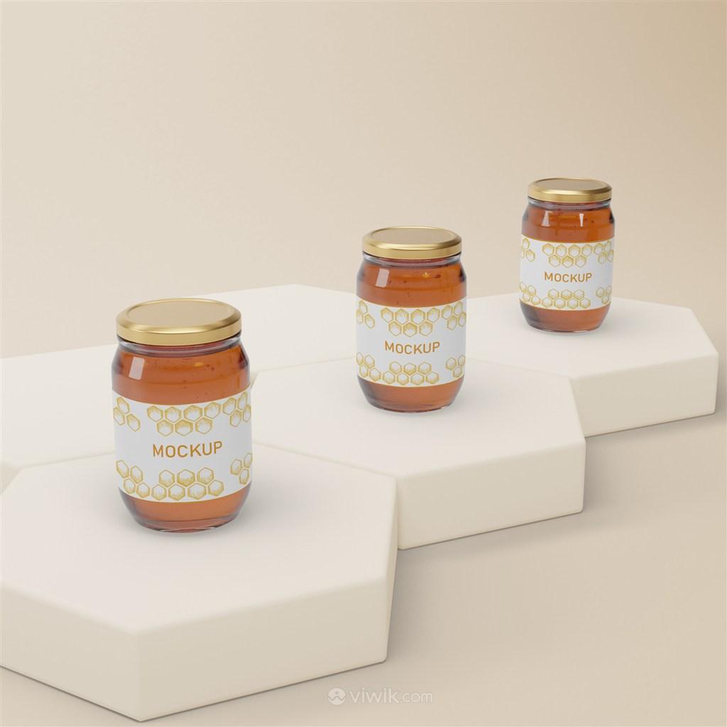 六边形展台上的椭圆形密封玻璃瓶蜂蜜包装贴图样机