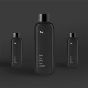 黑色化妆品护肤品瓶子包装贴图样机