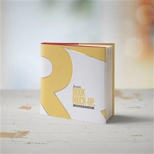 木桌上的正方形书本画册装帧设计样机